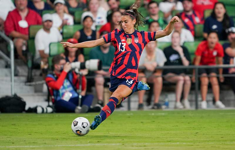 Alex Morgan of the United States crosses the ball against Nigeria during a WNT Summer Series game at Q2 Stadium on June 16, 2021 in Austin, Texas. (Photo by John Todd/ISI Photos/Getty Images)
