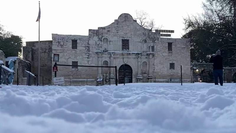 Residents, visitors in awe of The Alamo covered in snow