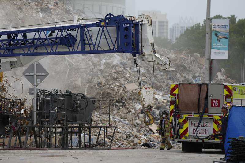 FILE - Crews work in the rubble of the demolished section of the Champlain Towers South building on Monday, July 12, 2021, in Surfside, Fla. (AP Photo/Rebecca Blackwell)