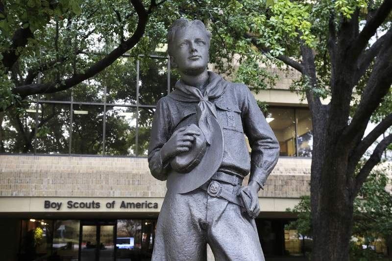 FILE - In this Feb. 12, 2020 file photo, a statue stands outside the Boys Scouts of America headquarters in Irving, Texas. Close to 90,000 sex-abuse claims have been filed against the Boy Scouts of America as the deadline arrived Monday, Nov. 16 for filing claims in the BSAs bankruptcy case. The number far exceeded initial projections of lawyers across the United States who have been signing up clients in the case since the Boy Scouts filed for bankruptcy protection in February in the face of hundreds of lawsuits. (AP Photo/LM Otero, File)