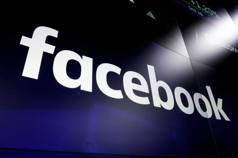 FILE - This March 29, 2018, file photo shows the Facebook logo on screens at the Nasdaq MarketSite, in New York's Times Square. Facebook said its readied new safeguards for the 2020 U.S. elections that have it better prepared to deal with candidates who prematurely declare victory or contest official results, as well as the possibility of voter intimidation by alleged, and potentially armed, poll watchers. (AP Photo/Richard Drew, File)