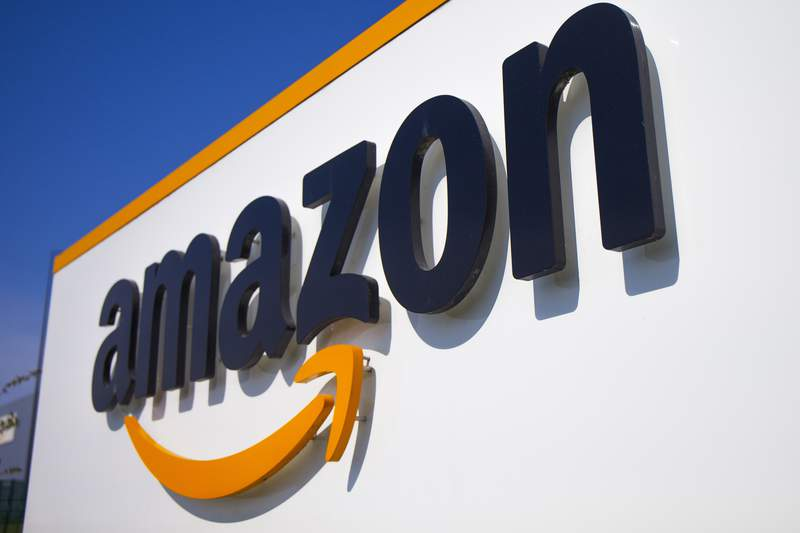 FILE - In this Thursday April 16, 2020 file photo, The Amazon logo is seen in Douai, northern France. Amazon is looking to kickstart holiday shopping early this year. The company said Monday, Sept. 28, 2020 that it will hold its annual Prime Day sales event over two days in October That's because the pandemic forced it to be postponed from July. Its the first time the sales event is being held in the fall. (AP Photo/Michel Spingler, File)