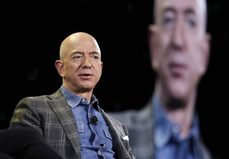 FILE - In this June 6, 2019, file photo Amazon CEO Jeff Bezos speaks at the the Amazon re:MARS convention in Las Vegas. Two U.N. experts this week called for the U.S. to investigate a likely hack of Bezos' phone that could have involved Saudi Arabian Crown Prince Mohammed bin Salman. A commissioned forensic report found with medium to high confidence that Bezos' phone was compromised by a video MP4 file he received from the prince in May 2018. (AP Photo/John Locher, File)