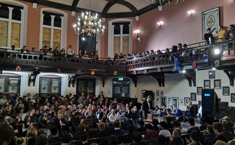 In this photo taken on Thursday, Nov. 21, 2019, audience members look on during a debate on the threat of artificial intelligence at the Cambridge Union, the worlds oldest debating society, Cambridge, England. IBMs artificial intelligence debating robot faced off against itself at Cambridge University, in a demonstration of what the future might hold. Project Debater, a robot that has already debated humans, was for the first time pitted against itself, at least in the first round of arguments at the Cambridge Union, the worlds oldest debating society. (AP Photo/James Brooks)