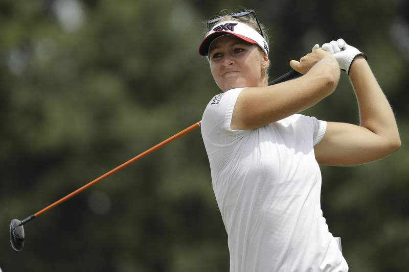 FILE - In this  Friday, May 31, 2019 file photo, Anna Nordqvist of Sweden, watches her ball on the 13th tee during the second round of the U.S. Women's Open golf tournament in Charleston, S.C. Anna Nordqvist drained a birdie putt on second playoff hole. The title in hand, the two-time major champion turned to playing partner Lisa Pettersson and hesitated. The major golf tours may have shut down during the coronavirus outbreak, but a handful of mini tours are playing through. (AP Photo/Steve Helber, File)