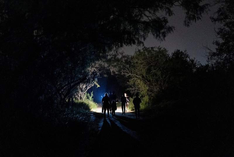 Asylum-seeking migrant families walked to turn themselves into the U.S. Border Patrol after crossing the Rio Grande river into the United States from Mexico in Roma on June 9, 2021.