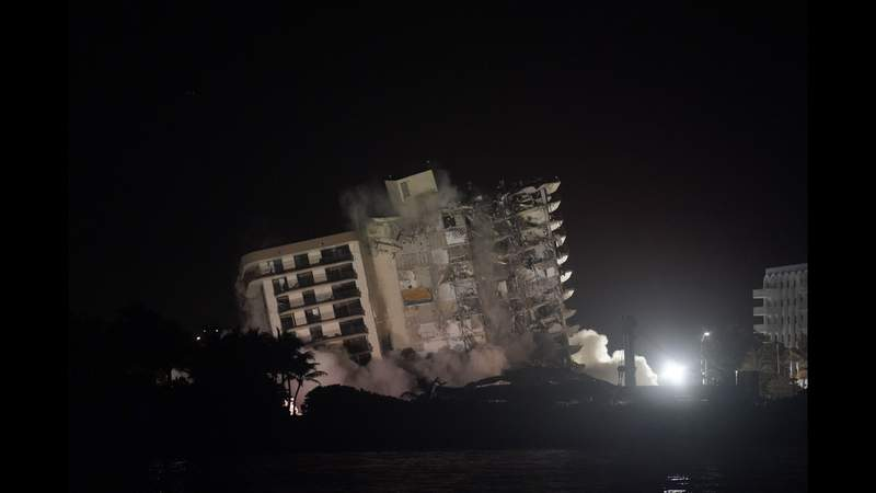 Explosives set off to bring down rest of collapsed condo