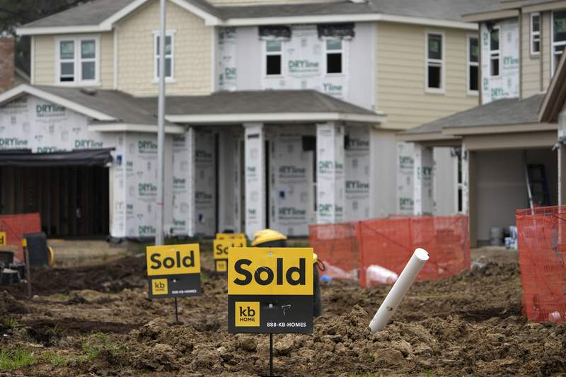 Sold signs stand in front of new homes under construction Monday, March 15, 2021, in Houston.  Sales of new homes fell a bigger-than-expected 5.9% in April, a drop that analysts blamed in part on soaring home prices.  (AP Photo/David J. Phillip)