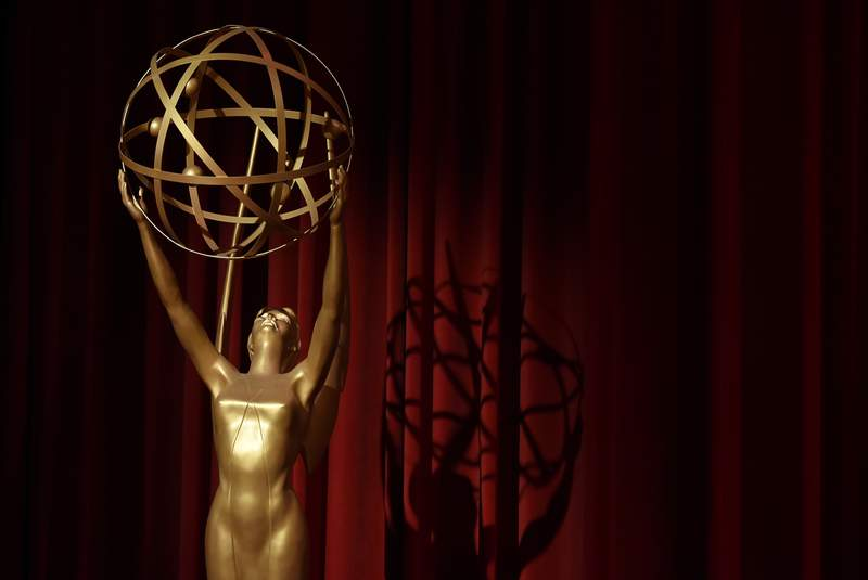FILE - In this July 12, 2018, file photo, an Emmy statue is displayed onstage at the 70th Primetime Emmy Nominations Announcements at the Television Academy's Saban Media Center, in Los Angeles. The Emmy Awards being held on Sunday, Sept. 20, 2020, will include a $2.8 million donation to No Kid Hungry to support the groups efforts to feed children affected by the coronavirus pandemic. The Television Academy announced the donation Friday, Sept. 18. (Photo by Chris Pizzello/Invision/AP, File)