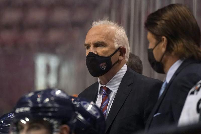 FILE - In this Friday, Feb. 5, 2021 file photo, Florida Panthers head coach Joel Quenneville looks on during the third period of an NHL hockey game against the Nashville Predators in Sunrise, Fla. Florida Panthers coach Joel Quenneville has offered to participate in the Chicago Blackhawks' review of allegations by a former player who says he was sexually assaulted by a then-assistant coach in 2010(AP Photo/Wilfredo Lee, File)
