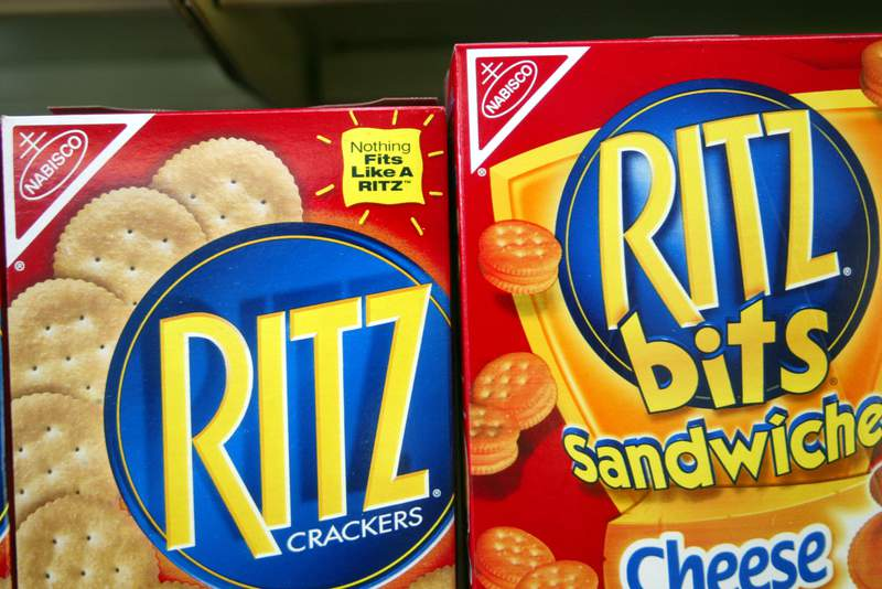 MIAMI - JULY 1:  Ritz crackers are displayed on a store shelf July 1, 2003 in Miami, Florida. Kraft Foods Inc., the nations largest food manufacturer and the maker of Nabisco cookies and crackers, plans to examine the nutrition of its products and take steps to fight obesity and promote health.  (Photo by Joe Raedle/Getty Images)