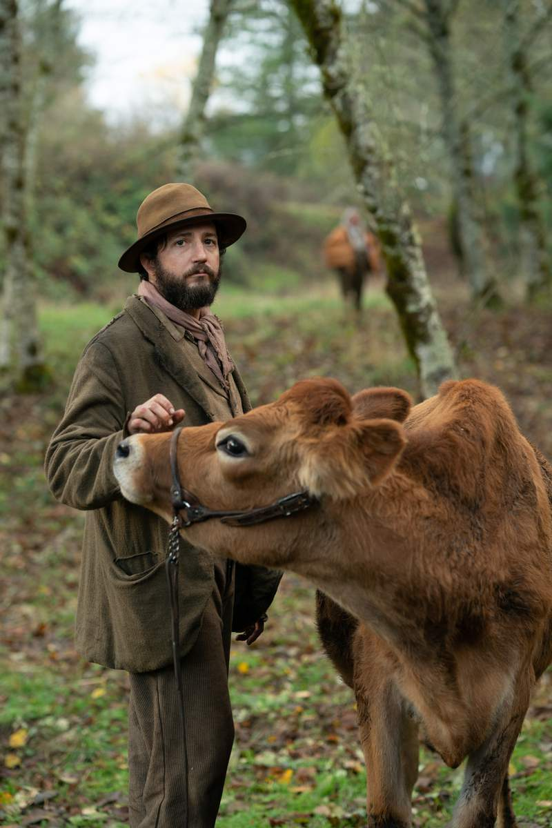 """This image released by A24 shows John Magaro in a scene from the film """"First Cow."""" The New York Film Critics Circle on Friday, Dec. 18, 2020, voted Kelly Reichardts Western fable First Cow the best film of 2020.  (Allyson Riggs/A24 via AP)"""
