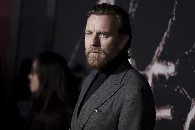 """FILE - In this Oct. 29, 2019 file photo, Ewan McGregor attends the LA premiere of """"Doctor Sleep"""" at the Regency Theatre Westwood in Los Angeles.  McGregor says any delay in completing work on in his new Obi-Wan Kenobi Star Wars series will be brief and is aimed at making the show better. McGregor addressed trade reports that the Disney Plus series had been placed on hold at an event Thursday, Jan. 23, 2020,  promoting his latest film Birds of Prey.  (Photo by Richard Shotwell/Invision/AP, File)"""