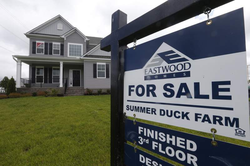FILE - This June 13, 2019, file photo shows a new home is for sale in Mechanicsville, Va.  On Thursday, March 12, 2020, U.S. long-term mortgage rates were mixed this week after hitting all-time lows last week amid anxiety over risks to the economy from the deepening coronavirus crisis.    (AP Photo/Steve Helber, File)