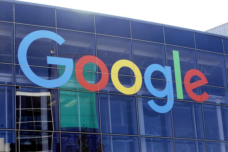 FILE - In this Sept. 24, 2019, file photo a sign is shown on a Google building at their campus in Mountain View, Calif.