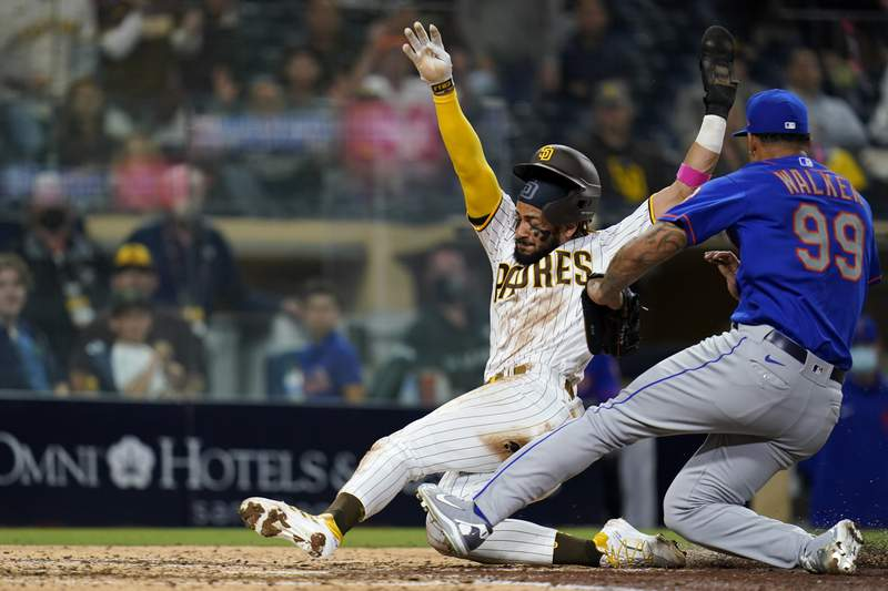San Diego Padres' Fernando Tatis Jr. scores from third on a wild pitch by New York Mets  pitcher Taijuan Walker (99) during the fifth inning of a baseball game Thursday, June 3, 2021, in San Diego. (AP Photo/Gregory Bull)