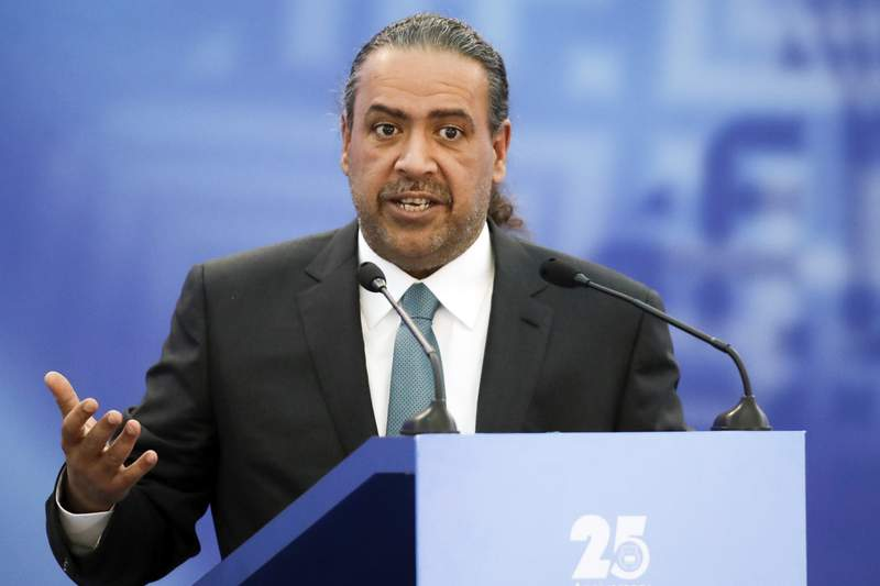 FILE - In this Friday, Oct. 21, 2016 file photo, Kuwait's Sheikh Ahmad Al-Fahad Al-Ahmed Al-Sabah, president of the Association of National Olympic Committees (ANOC) speaks at the European Olympic Committees General Assembly in Minsk, Belarus. Documents obtained by The Associated Press show two senior Olympic officials from Kuwait have been targeted by the U.S. Department of Justice for suspected racketeering and bribery related to FIFA and international soccer politics. Sheikh Ahmad Al-Fahad Al-Ahmed Al-Sabah is reputed to be the kingmaker of IOC elections. Husain al-Musallam is president of swimmings international governing body. The documents include details of the DOJ investigation and a formal request to Kuwaiti authorities in 2017 for help to secure evidence. (AP Photo/Sergei Grits, File)