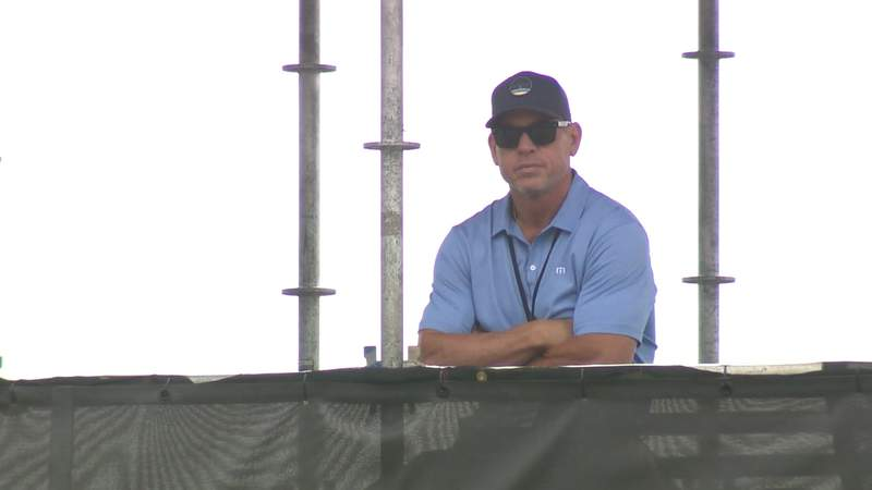 Hall of Fame quarterback Troy Aikman examines team practice at Cowboys training camp in Oxnard, California on Sunday, July 25, 2021.