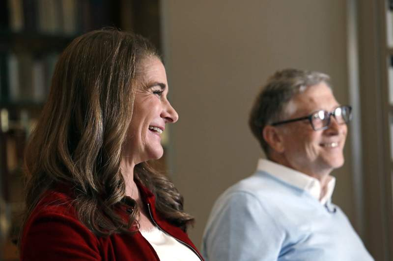 FILE-In this Feb. 1, 2019, file photo Bill and Melinda Gates are interviewed in Kirkland, Wash.  Bill and Melinda Gates namesake foundation announced Wednesday, June 30, 2021, it will spend $2.1 billion to advance global gender equality. It comes as private donors, government officials and civil society leaders gather at a forum in Paris to make financial and political commitments aimed at aiding women and girls. (AP Photo/Elaine Thompson, File)