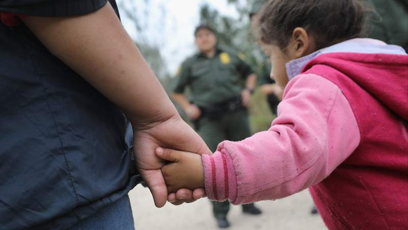 U.S. Border Patrol agents take Central American immigrants into custody near McAllen, Texas. (Photo by John Moore/Getty Images)