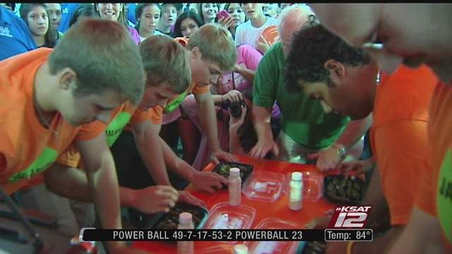 A large crowd packed a local Whataburger Wednesday to watch MacArthur and Johnson high schools battle it out in a jalapeno eating contest ahead of their football face-off Saturday.