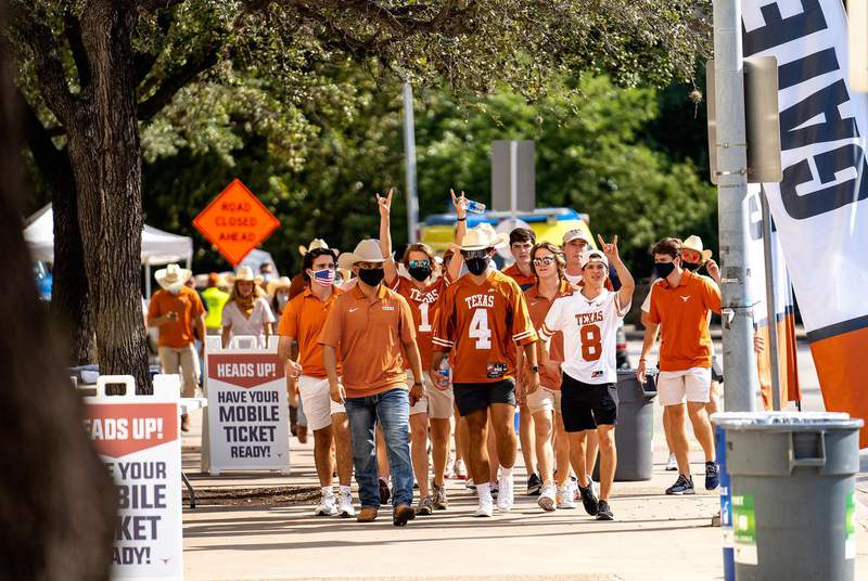 Fans walk toward the stadium for the first home football game of the season at the University of Texas at Austin. Students had to test negative for the coronavirus before attending the game.                    Credit: Jordan Vonderhaar for the Texas Tribune