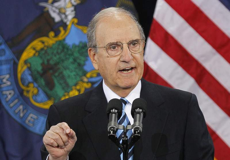 FILE- In this March 30, 2012, file photo former Senate Majority Leader George Mitchell speaks in South Portland, Maine. The former senator and peace envoy to Northern Ireland, is beginning treatment for leukemia at a Boston hospital on Friday, Aug. 21, 2020, a day after his 87th birthday. (AP Photo/Robert F. Bukaty, File)