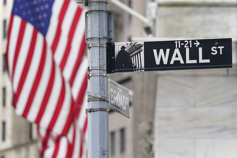 FILE - A street sign is displayed at the New York Stock Exchange in New York, Monday, Nov. 23, 2020. Stocks are opening higher on Wall Street, Wednesday, Feb. 10, 2021 as investors get back to buying a day after the S&P 500 ended a six-day winning streak.   (AP Photo/Seth Wenig)