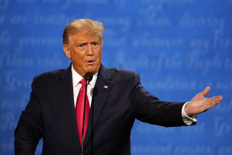 President Donald Trump speaks during the second and final presidential debate Thursday, Oct. 22, 2020, at Belmont University in Nashville, Tenn., with Democratic presidential candidate former Vice President Joe Biden. (AP Photo/Julio Cortez)
