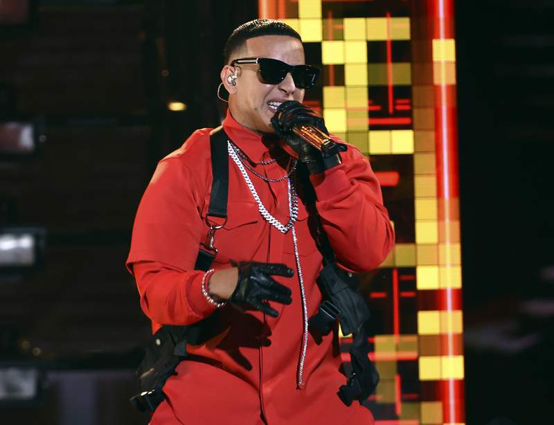 """FILE - Daddy Yankee performs at the Latin American Music Awards in Los Angeles on Oct. 17, 2019. On Friday, Dec. 6, Daddy Yankee is releasing the first of three parts of DY2K20, a digital version of his 12 sold-out concert series Con Calma Pal Choli."""" The show will air for free, in three parts, on his YouTube channel. (Photo by Chris Pizzello/Invision/AP, File)"""