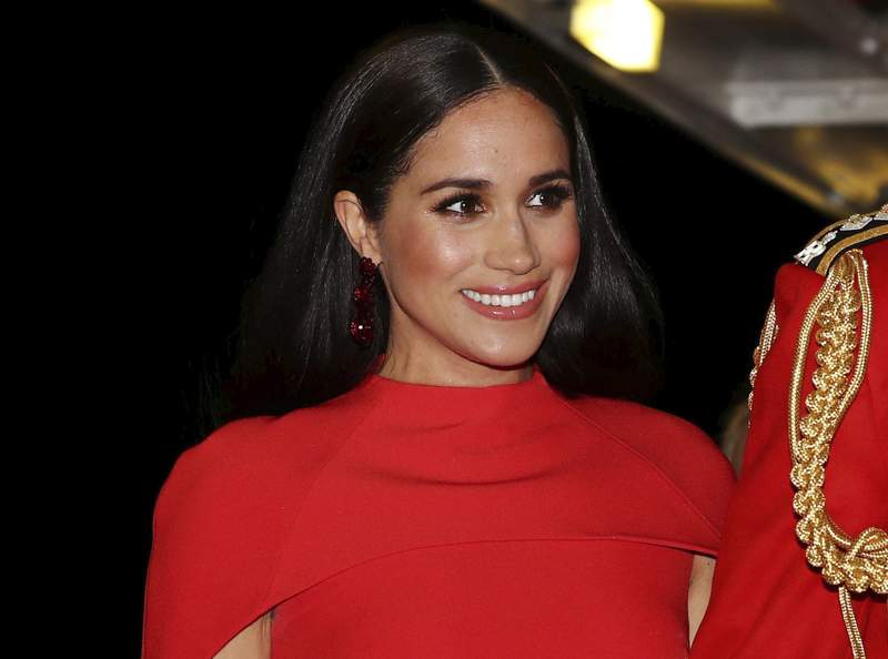 FILE - In this Saturday March 7, 2020 file photo, Meghan, Duchess of Sussex with Prince Harry arrives at the Royal Albert Hall in London, to attend the Mountbatten Festival of Music. A British judge ruled Thursday Feb. 11, 2021, that a newspaper invaded Duchess of Sussexs privacy by publishing personal letter to her estranged father. (Simon Dawson/Pool via AP, File)