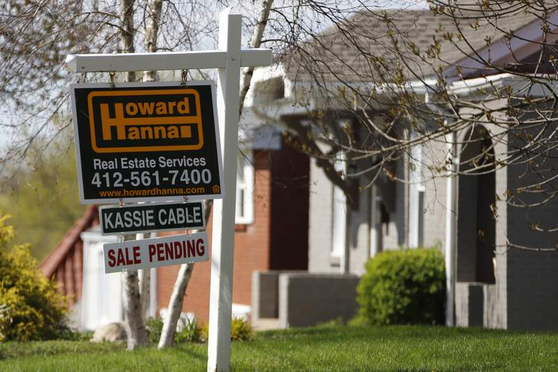 FILE - This April 27, 2020, file photo shows a sale pending sign on a home in Mount Lebanon, Pa. U.S. average rates on long-term mortgages rose this week though they remain at historically low levels. The key 30-year loan nudged toward 3%. Mortgage buyer Freddie Mac reports that the average rate on the 30-year home loan increased to 2.99% from 2.96% last week.   (AP Photo/Gene J. Puskar, File)