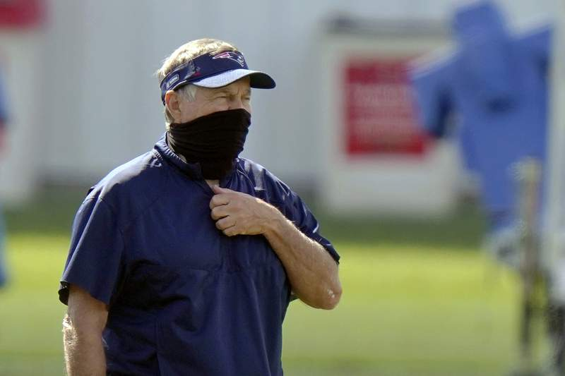 New England Patriots head coach Bill Belichick watches his team practice during an NFL football training camp, Wednesday, Aug. 26, 2020, in Foxborough, Mass. (AP Photo/Steven Senne, Pool)