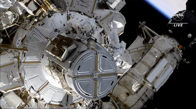 This photo provided by NASA shows astronauts NASA's Shane Kimbrough and France's Thomas Pesquet during a space walk outside the International Space Station on Friday, June 25, 2021.  The astronauts are working to install another new solar panel outside the station.  (NASA via AP)
