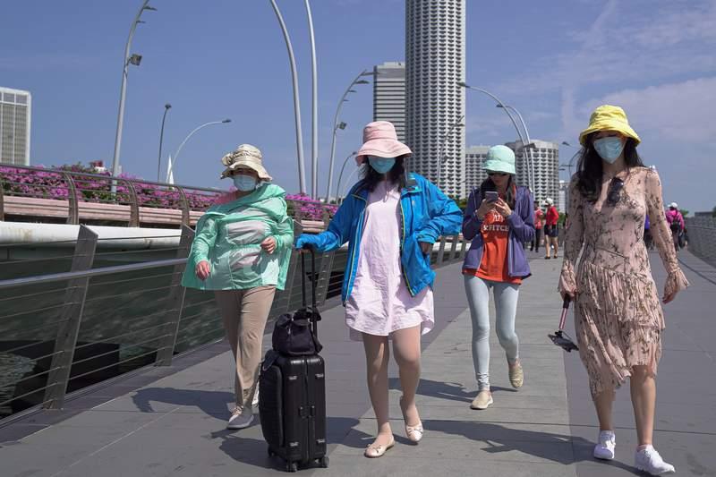 People walking in Singapore.