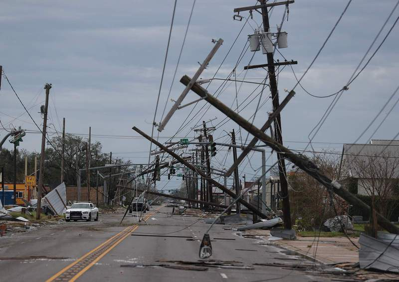 A street is seen strewn with debris and downed power lines after Hurricane Laura passed through the area on August 27, 2020 in Lake Charles, Louisiana . The hurricane hit with powerful winds causing extensive damage to the city. (Photo by Joe Raedle/Getty Images) (2020 Getty Images)
