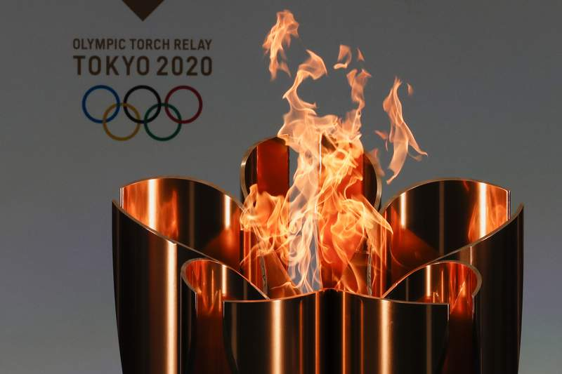 FILE - In this March 25, 2021, file photo, the celebration cauldron is seen lit on the first day of the Tokyo 2020 Olympic torch relay in Naraha, Fukushima prefecture, northeastern Japan. The governor of Osaka prefecture said on Thursday that he wants to cancel the Olympic torch relay legs going through Osaka later this month. (Kim Kyung-Hoon/Pool Photo via AP, File)