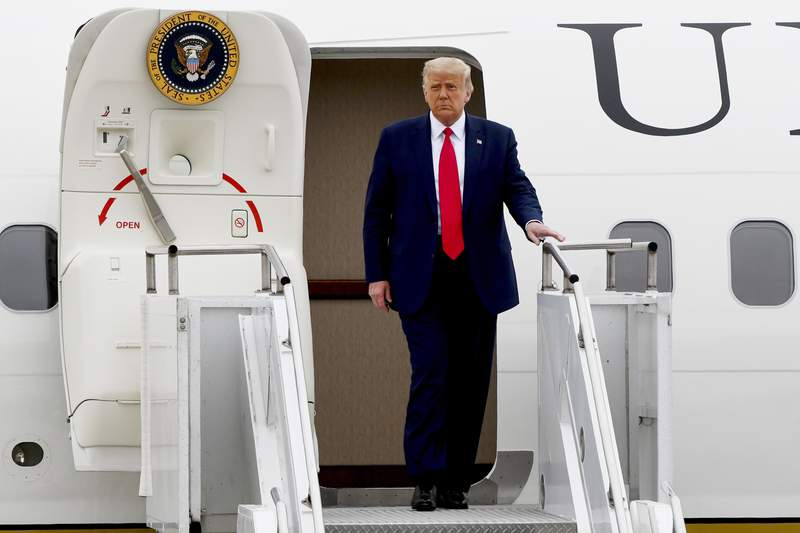 President Donald Trump walks from Air Force One as he arrives at Waukegan National Airport before attending a series of events in Kenosha, WI, Tuesday, Sept. 1, 2020, in Waukegan, IL. (AP Photo/Matt Marton)