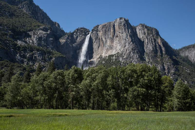 The iconic upper Yosemite Falls is viewed flowing at record levels on July 1, 2019, in Yosemite Valley, California.
