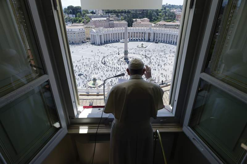 Pope Francis delivers his blessing from his studio window overlooking St. Peter's Square at the Vatican, Sunday, May 31, 2020. Francis celebrated a Pentecost Mass in St. Peter's Basilica on Sunday, albeit without members of the public in attendance. He will then went to his studio window to recite his blessing at noon to the crowds below. The Vatican says police will ensure the faithful gathered in the piazza keep an appropriate distance apart. (Vatican News via AP)