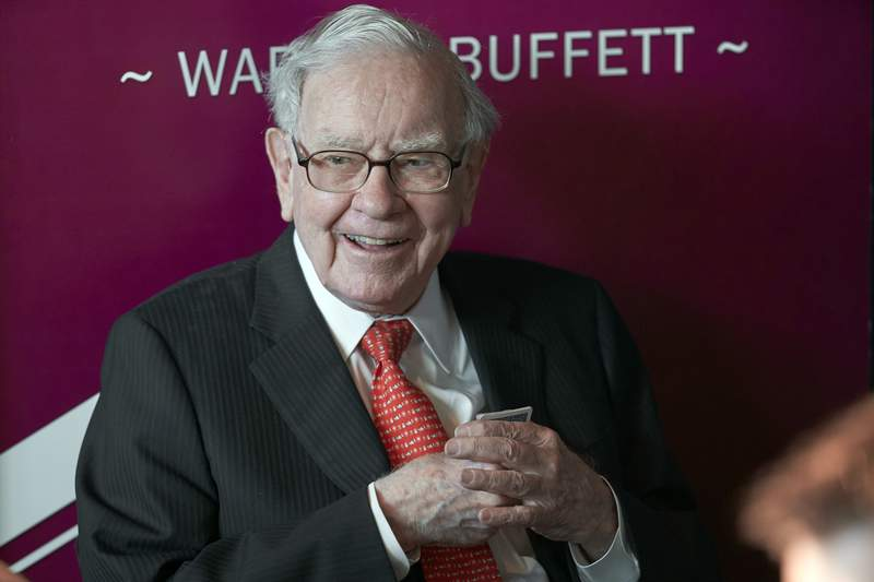 FILE - In this May 5, 2019, file photo Warren Buffett, Chairman and CEO of Berkshire Hathaway, smiles as he plays bridge following the annual Berkshire Hathaway shareholders meeting in Omaha, Neb. Warren Buffett made a $4.1 billion annual philanthropic contribution and said hes halfway through his goal of giving away most of his money. The billionaire investor also said he is stepping down as trustee of the Bill and Melinda Gates Foundation as he exits all other corporate boards. (AP Photo/Nati Harnik, File)