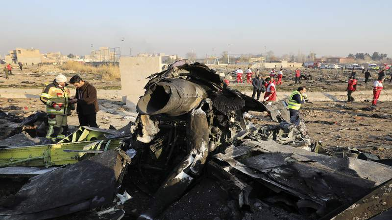 """FILE - In this Wednesday, Jan. 8, 2020 file photo debris at the scene where a Ukrainian plane crashed in Shahedshahr southwest of the capital Tehran, Iran. Two U.S. officials said Thursday that it was """"highly likely"""" that an Iranian anti-aircraft missile downed a Ukrainian jetliner late Tuesday, killing all 176 people on board. President Donald Trump is suggesting he believes Iran was responsible.  (AP Photo/Ebrahim Noroozi)"""