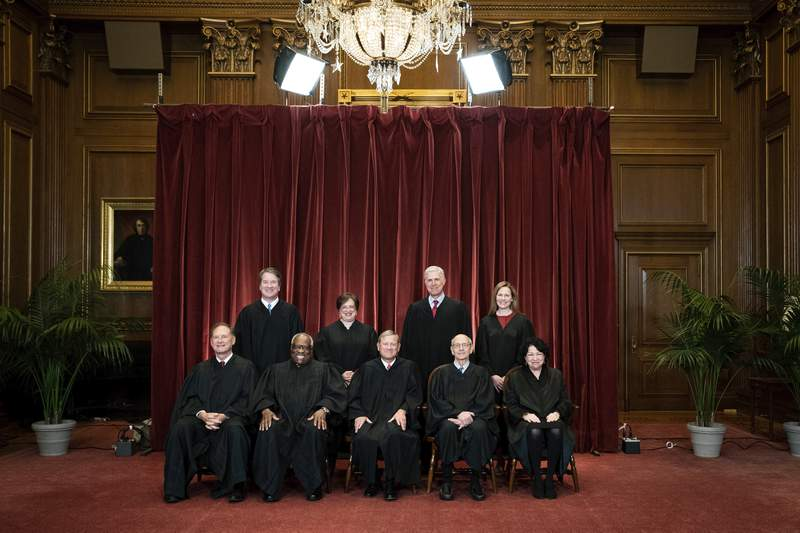 Members of the Supreme Court pose for a group photo at the Supreme Court in Washington, Friday, April 23, 2021. Seated from left are Associate Justice Samuel Alito, Associate Justice Clarence Thomas, Chief Justice John Roberts, Associate Justice Stephen Breyer and Associate Justice Sonia Sotomayor, Standing from left are Associate Justice Brett Kavanaugh, Associate Justice Elena Kagan, Associate Justice Neil Gorsuch and Associate Justice Amy Coney Barrett. (Erin Schaff/The New York Times via AP, Pool)