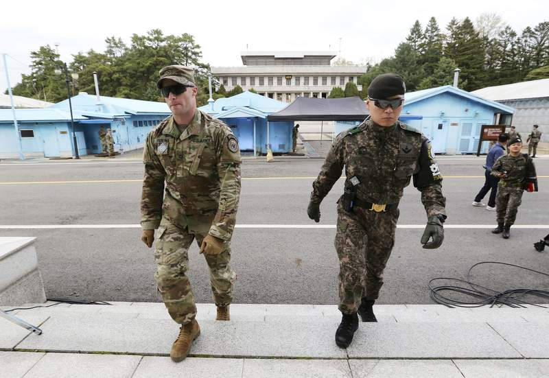 FILE - In this April 26, 2019 file photo, South Korean and U.S. Army, left, soldiers patrol during a rehearsal to mark the first anniversary of a summit between South Korean President Moon Jae-in and North Korean leader Kim Jong Un on April 27, at the border village of Panmunjom in the demilitarized zone (DMZ) between the two Koreas in Paju, South Korea. U.S. and South Korean officials say has Seoul agreed to a 13.9% increase in payments to cover this year's cost of basing U.S. troops on the Korean peninsula. (AP Photo/Ahn Young-joon)