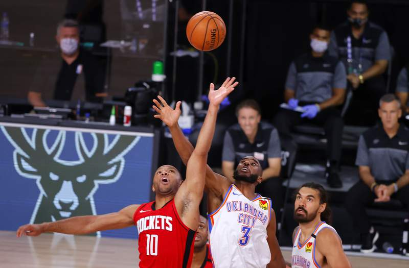 Houston Rockets' Eric Gordon (10) and Oklahoma City Thunder's Chris Paul (3) battle for the tipoff during the fourth quarter of Game 2 of an NBA basketball first-round playoff series, Thursday, Aug. 20, 2020, in Lake Buena Vista, Fla. (Kevin C. Cox/Pool Photo via AP)