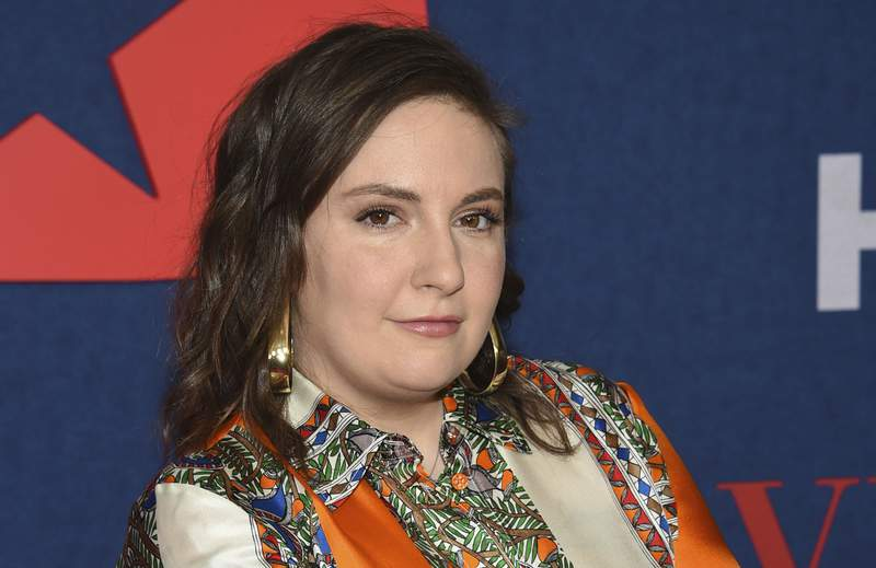 """FILE - Lena Dunham attends the premiere of the final season of HBO's """"Veep"""" on March 26, 2019, in New York. Dunham says her body revolted during a struggle with COVID-19. The 34-year-old creator and star of HBO's Girls said in a long Instagram post Friday, July 31, 2020, that what began as moderate aches were followed by a high fever, crushing fatigue, and the feeling that she was losing control of her body. She said the serious symptoms subsided after three weeks and she tested negative after a month. Dunham says she is telling her story now because she is seeing too much carelessness amid the pandemic. (Photo by Evan Agostini/Invision/AP, File)"""