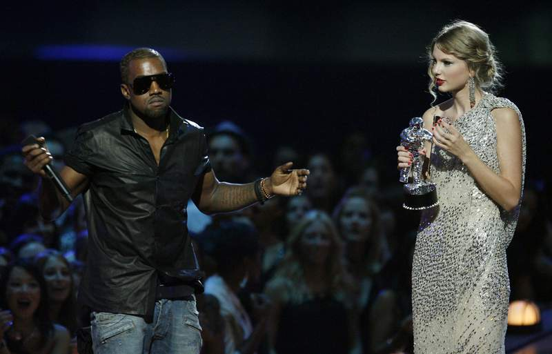 "FILE - In this Sept. 13, 2009 file photo, singer Kanye West takes the microphone from singer Taylor Swift as she accepts the ""Best Female Video"" award during the MTV Video Music Awards  in New York.   Swift may have ended her feud with Katy Perry but the one with Kanye West seems simply not to want to die. New leaked video clip of the entire four-year-old phone call between the rapper and pop superstar about his controversial song ""Famous"" have been posted online and further complicate the picture of what happened.(AP Photo/Jason DeCrow, File)"