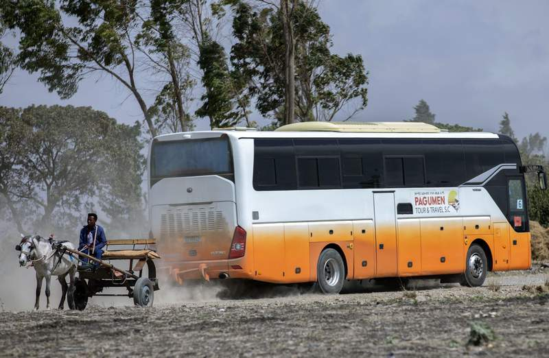 Relatives in buses arrive to attend the memorial service for the one-year anniversary of the crash of Ethiopian Airlines Flight ET302 in the rural Tulufera area near Bishoftu, south-east of the capital Addis Ababa, in Ethiopia Tuesday, March 10, 2020. Grim-faced, visibly grief-stricken, some crying, hundreds of family members gathered Tuesday for a memorial service at the site where one year ago the jet crashed into the rocky ground, killing all 157 on board. (AP Photo/Mulugeta Ayene)