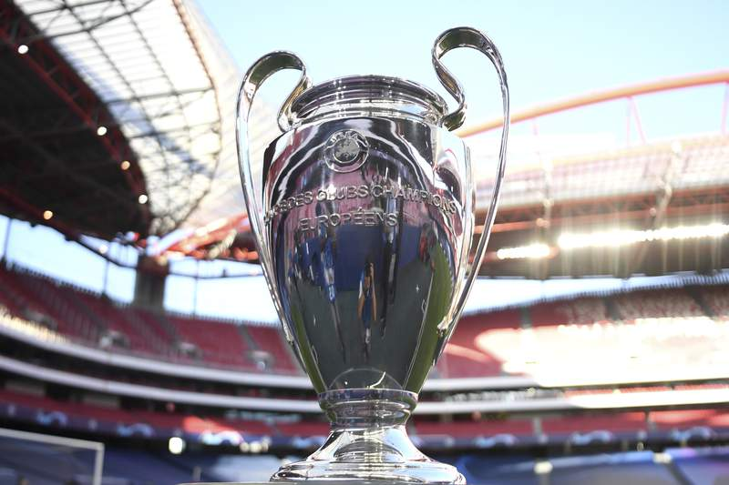 FILE - In this Tuesday, Aug. 18, 2020 file photo, the Champions League trophy is displayed before the semifinal soccer match between RB Leipzig and Paris Saint-Germain at the Luz stadium in Lisbon, Portugal. Chelsea and Manchester City are due to meet on May 29 in Istanbul and UEFA was hoping to allow around 10,000 fans into the biggest club game of the European football season. But the British government on Friday May 7, 2021 warned supporters not to travel to Turkey after imposing the new travel restrictions, and said the English Football Association was in talks with Champions League organizer UEFA about staging the game in Britain, instead. (David Ramos/Pool Photo via AP, File)