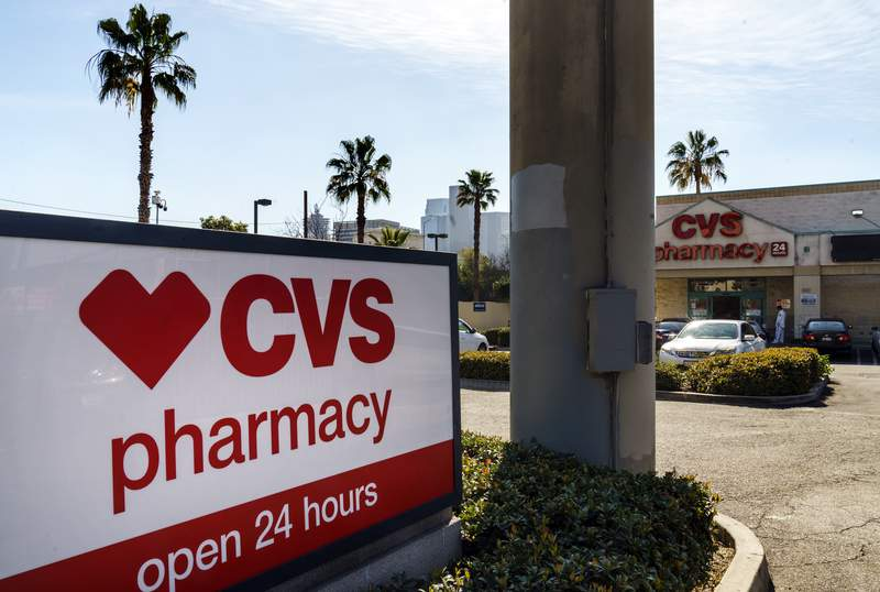 FILE - In this Wednesday, Feb. 3, 2021 file photo, a CVS pharmacy is seen in Los Angeles. CVS Health Corporation (CVS) on Tuesday, Feb. 16 reported a fourth-quarter net income of $973 million. (AP Photo/Damian Dovarganes, File)
